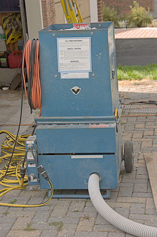 The blower machine that pushes the insulation up two storeys.